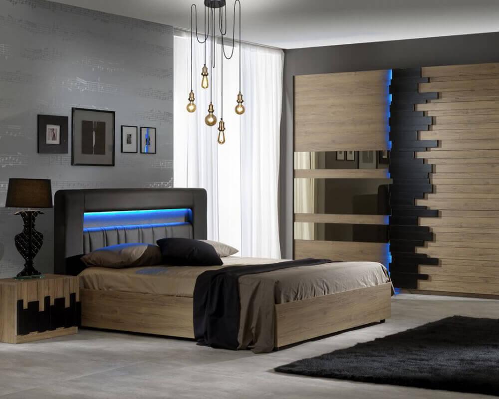 Modernes Schlafzimmer Set mit schwarzen Zierelementen bestehend aus Nachttisch, Bett und Schwebetürenschrank.