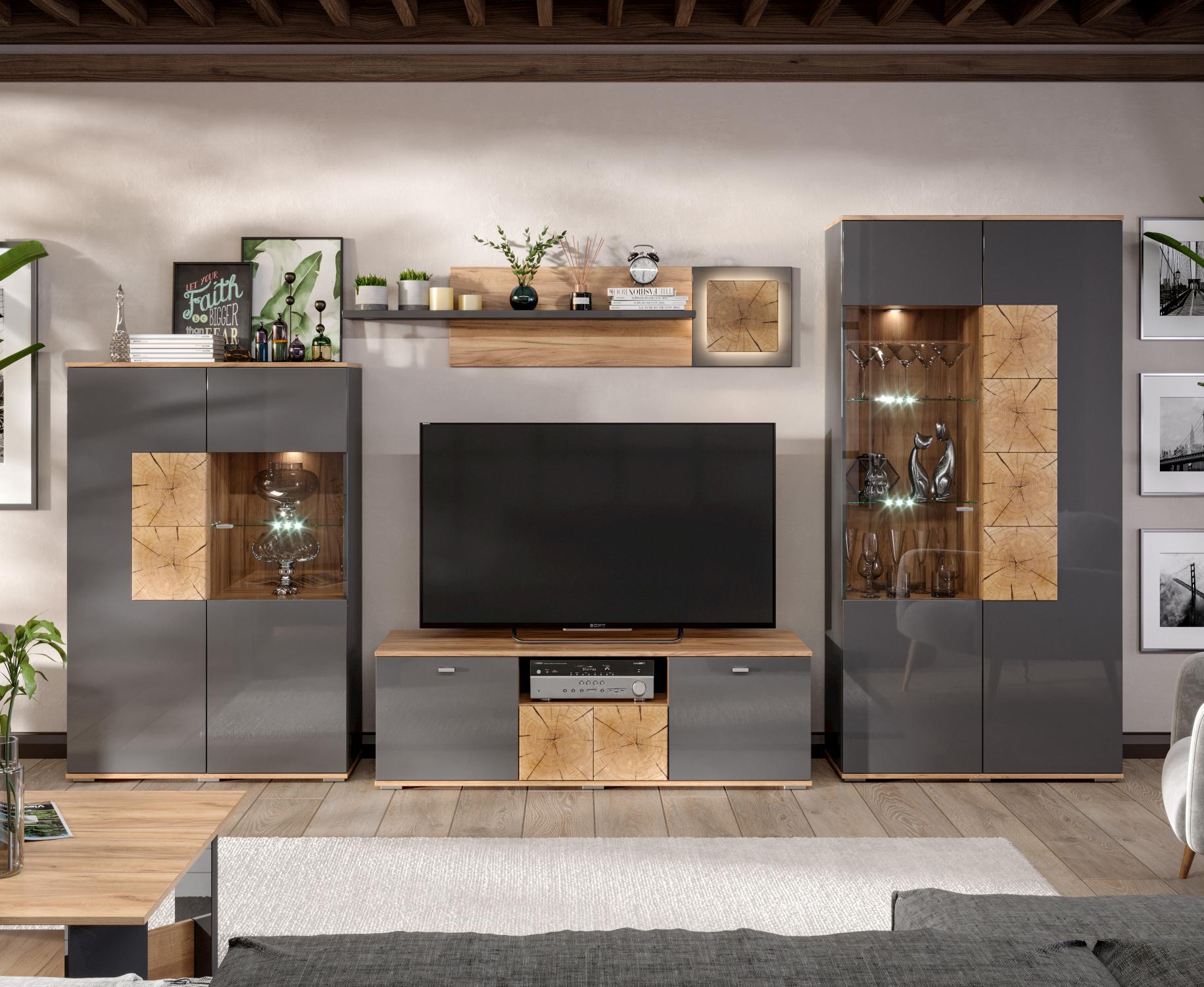 Graues Wohnwand Set bestehend aus Vitrinenschränken, Lowboard, und Wandregal.
